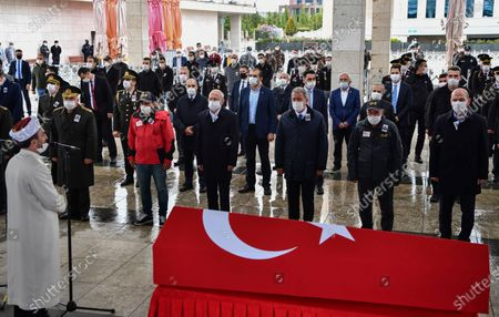Turkey's Defense Minister Hulusi Akar, third right, the main opposition Republican People's Party leader Kemal Kilicdaroglu, third left, family members and army commanders, wearing face masks and keeping social distance to protect against coronavirus, attend funeral prayers for soldier Yilmaz Günes at the Ahmet Hamdi Akseki Mosque, in Ankara, Turkey