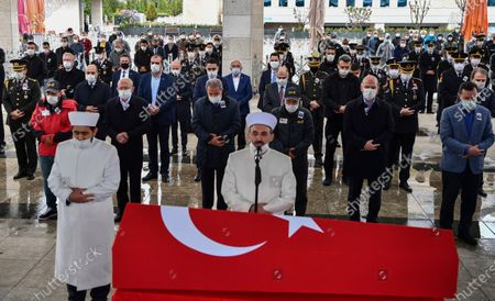 Turkey's Defense Minister Hulusi Akar, third left, the main opposition Republican People's Party leader Kemal Kilicdaroglu, second left, family members and army commanders, wearing face masks and keeping social distance to protect against coronavirus, attend funeral prayers for soldier Yilmaz Günes at the Ahmet Hamdi Akseki Mosque, in Ankara, Turkey