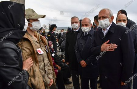 Stock Image of Turkey's main opposition Republican People's Party leader Kemal Kilicdaroglu, right, and family members, wearing face masks and keeping social distance to protect against coronavirus, speak during the funeral prayers for soldier Yilmaz Günes at the Ahmet Hamdi Akseki Mosque, in Ankara, Turkey