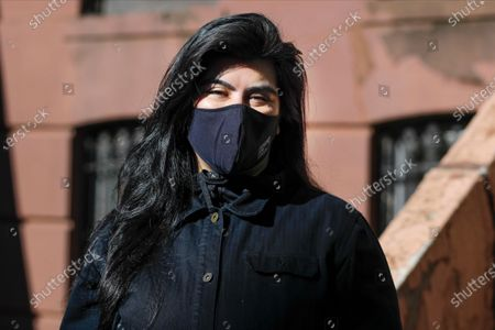 """Isabella Gutierrez wears a face mask as she poses for a portrait, in the Brooklyn borough of New York. Namm has been cooking professionally for about eight years, and has always loved it, however, her restaurant shut down because of the coronavirus pandemic. Even when the restrictions are lifted and businesses start opening up, """"I, for one, don't see myself returning to restaurant work after this,"""" she said. """"There's going to be less money in it"""