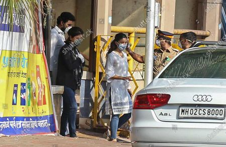 Bollywood actors Abhishek Bachchan (L), Alia Bhatt (R) and actress Nitu Singh (C) leaves after attending the funeral of her husband Rishi Kapoor, in Mumbai, India, 30 April 2020. According to media reports, Kapoor died at a hospital in Mumbai on 30 April. He was diagnosed with cancer in 2018. The news broke just one day after another Bollywood actor, Irrfan Khan, had passed away.