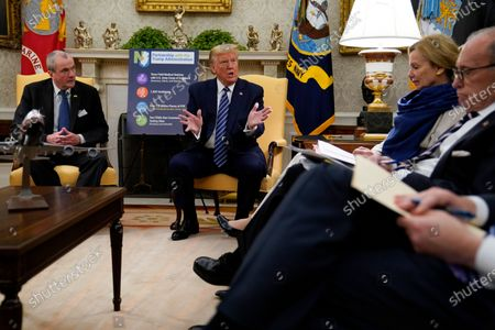 President Donald Trump speaks during a meeting about the coronavirus response with Gov. Phil Murphy, D-N.J., left, in the Oval Office of the White House, in Washington. White House chief economic adviser Larry Kudlow, right, and White House coronavirus response coordinator Dr. Deborah Birx, second from right, listen