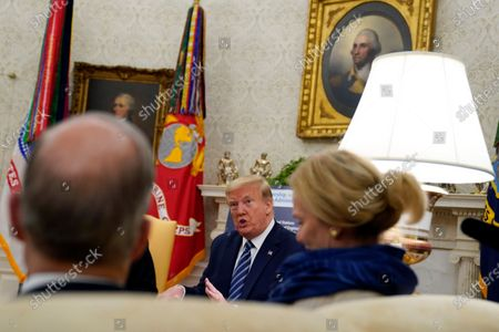 President Donald Trump speaks during a meeting about the coronavirus response with Gov. Phil Murphy, D-N.J., in the Oval Office of the White House, in Washington. White House chief economic adviser Larry Kudlow, left, and White House coronavirus response coordinator Dr. Deborah Birx, right, listen