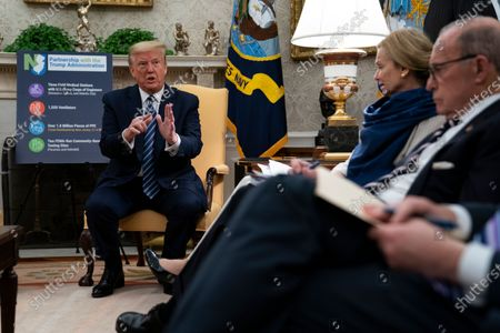 White House chief economic adviser Larry Kudlow and White House coronavirus response coordinator Dr. Deborah Birx listen as President Donald Trump speaks during a meeting about the coronavirus response with Gov. Phil Murphy, D-N.J., in the Oval Office of the White House, in Washington