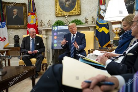 Stock Photo of United States President Donald J. Trump makes remarks as he meets with Governor Phil Murphy (Democrat of New Jersey) in the Oval Office of the White House in Washington, DC,. Seated at right is Dr. Deborah L. Birx, White House Coronavirus Response Coordinator.