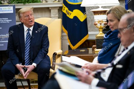 United States President Donald Trump makes remarks as he meets with Governor Phil Murphy (Democrat of New Jersey) in the Oval Office of the White House in Washington, DC,. Looking on at right are Dr. Deborah L. Birx, White House Coronavirus Response Coordinator and Director of the National Economic Council Larry Kudlow.