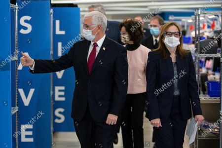 Stock Picture of Vice President Mike Pence tours the General Motors/Ventec ventilator production facility with GM CEO and Chairman Mary Barra in Kokomo, Ind