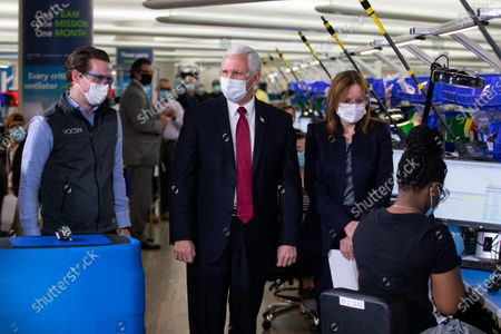 Stock Image of Vice President Mike Pence tours the General Motors/Ventec ventilator production facility with GM CEO and Chairman Mary Barra, second from right, and Chris Kiple of Ventec, left, in Kokomo, Ind