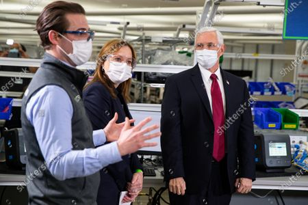 Vice President Mike Pence listens on a tour of the General Motors/Ventec ventilator production facility to Chris Kiple of Ventec along with GM CEO and Chairman Mary Barra in Kokomo, Ind