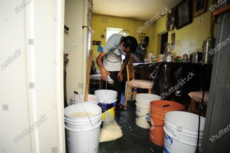 "Carlos Beltran  worker of ""La Paloma Azul""  who has close  due  the lockdown, is seen during the preparation of the traditional Mexican drink ""Pulque"" that he makes at home during the Coronavirus pandemic. Carlos Beltran who has been dedicated to the elaboration of this pre-Hispanic drink that is part of the Mexican gastronomy, for more than 12 years has had to offer home service to continue with his job.  to prepare the traditional ""Pulque"" he takes more than 5 hours , he starting with the mixture of herbs and fruits until fermentation and finally bottled."