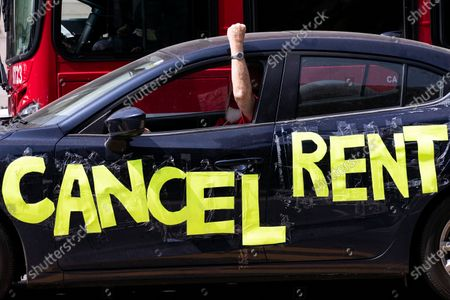 A protester drives by in a car with the message 'Cancel Rent' taped on during a rent strike demonstration in front of the Downtown City Hall amid the coronavirus pandemic in Los Angeles, California, USA, 30 April 2020.