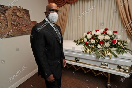 Andre Dawson poses for a photo at Paradise Memorial Funeral Home, in Miami. For baseball Hall of Famer Andre Dawson, owning a funeral home has taken some getting used to. Now he's adjusting to life as a mortician in Miami during a global pandemic. He wears a mask and gloves, and explains to customers that services in the chapel must be shorter than normal and limited to 10 people