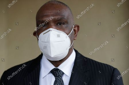 Baseball Hall of Famer Andre Dawson poses for a photo at his funeral business, Paradise Memorial Funeral Home, in Miami
