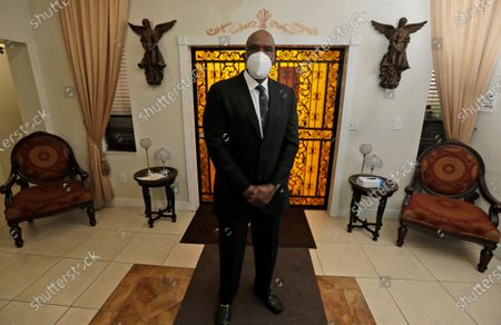 Stock Picture of Baseball Hall of Famer Andre Dawson poses for a photo at Paradise Memorial Funeral Home, in Miami. Dawson was inducted into the Hall of Fame in 2010. He showed traits as a player that have made him a successful mortician, said his brother, Vincent Brown, who has been involved in the funeral business since 1985
