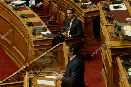 Greek Prime Minister Kyriakos Mitsotakis (left) is looking at President of Syriza Alexis Tsipras (right), during his speech in Hellenic Parliament.