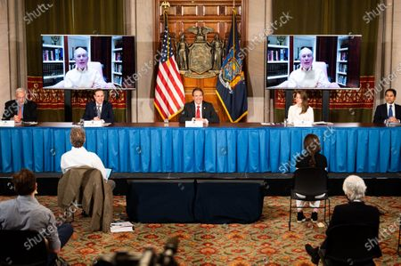 New York Governor, Andrew Cuomo (D) and via videoconferencing, former New York City Mayor, Mike Bloomberg (D) speaking during a press conference on corona virus at the State Capitol.
