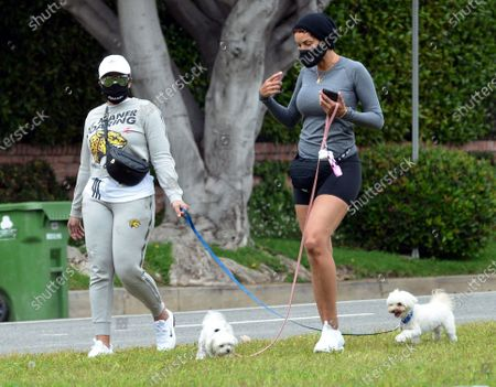 Stock Image of Nicole Murphy and Bria L Murphy out and about walking their dogs during quarantine