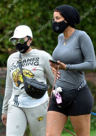 Nicole Murphy and Bria L Murphy out and about walking their dogs during quarantine