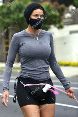 Nicole Murphy out and about wearing a face mask during quarantine