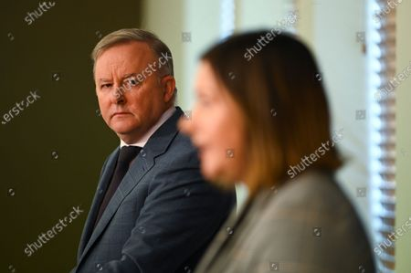 Preselection candidate for the seat of Eden-Monaro Kristy McBain (R) speaks to the media as Australian Opposition Leader Anthony Albaooks on during a press conference at Parliament House in Canberra, Australia, 01 May 2020. Albanese is endorcing McBain in the upcoming Eden-Monaro by-election.
