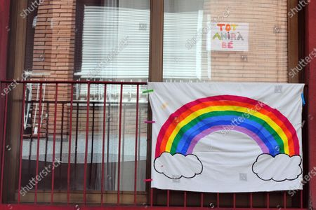 A banner with a colourful rainbow hangs on a balcony of a house during the coronavirus crisis. People hang hand painted pictures with messages of hope, love and courage, hearts and rainbows on their balconies to encourage their neighbours during the confinement amid coronavirus crisis.