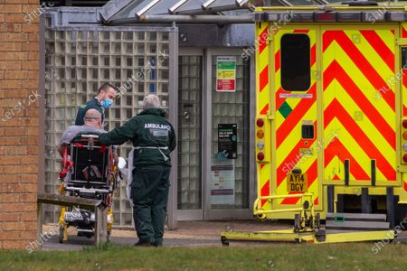 Stock Picture of Ambulance crews taking in patients to the Covid-19 ward  at the Queen Elizabeth Hospital  in King's Lynn in Norfolk on Wednesday afternoon.Ambulance drivers were today (Wed) seen delivering patients with suspected coronavirus into the hospital close to the Queen's Norfolk estate Ð where Prince William and Kate are currently staying with their children.NHS staff were seen pushing the patients on trollies into the Queen Elizabeth Hospital (QEH) in King's Lynn, which is just six miles from Sandringham, where the Royal couple are currently living at Anmer Hall with Prince George, Princess Charlotte and Prince Louis.Chrissie Emerson, a healthcare assistant at the hospital, died from coronavirus just over a week ago and yesterday it was revealed that 11 more patients who had tested positive for coronavirus had died at the hospital.