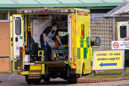 Ambulance crews cleaning their vehicle after taking in patients to the Covid-19 ward at the Queen Elizabeth Hospital  in King's Lynn in Norfolk on Wednesday afternoon.Ambulance drivers were today (Wed) seen delivering patients with suspected coronavirus into the hospital close to the Queen's Norfolk estate Ð where Prince William and Kate are currently staying with their children.NHS staff were seen pushing the patients on trollies into the Queen Elizabeth Hospital (QEH) in King's Lynn, which is just six miles from Sandringham, where the Royal couple are currently living at Anmer Hall with Prince George, Princess Charlotte and Prince Louis.Chrissie Emerson, a healthcare assistant at the hospital, died from coronavirus just over a week ago and yesterday it was revealed that 11 more patients who had tested positive for coronavirus had died at the hospital.