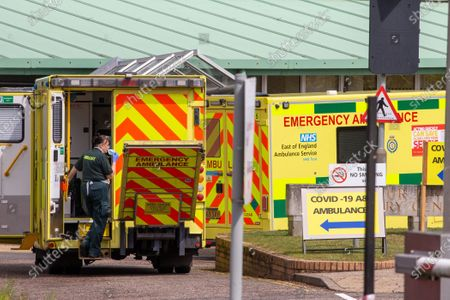 An ambulance worker taking a breather  after taking in patients to the Covid-19 ward at the Queen Elizabeth Hospital in King's Lynn in Norfolk on Wednesday afternoon.Ambulance drivers were today (Wed) seen delivering patients with suspected coronavirus into the hospital close to the Queen's Norfolk estate Ð where Prince William and Kate are currently staying with their children.NHS staff were seen pushing the patients on trollies into the Queen Elizabeth Hospital (QEH) in King's Lynn, which is just six miles from Sandringham, where the Royal couple are currently living at Anmer Hall with Prince George, Princess Charlotte and Prince Louis.Chrissie Emerson, a healthcare assistant at the hospital, died from coronavirus just over a week ago and yesterday it was revealed that 11 more patients who had tested positive for coronavirus had died at the hospital.