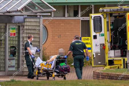 Ambulance crews taking in patients to the Covid-19 ward  at the Queen Elizabeth Hospital  in King's Lynn in Norfolk on Wednesday afternoon.Ambulance drivers were today (Wed) seen delivering patients with suspected coronavirus into the hospital close to the Queen's Norfolk estate Ð where Prince William and Kate are currently staying with their children.NHS staff were seen pushing the patients on trollies into the Queen Elizabeth Hospital (QEH) in King's Lynn, which is just six miles from Sandringham, where the Royal couple are currently living at Anmer Hall with Prince George, Princess Charlotte and Prince Louis.Chrissie Emerson, a healthcare assistant at the hospital, died from coronavirus just over a week ago and yesterday it was revealed that 11 more patients who had tested positive for coronavirus had died at the hospital.