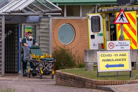 Ambulance crews after taking in patients to the Covid-19 ward  at the Queen Elizabeth Hospital  in King's Lynn in Norfolk on Wednesday afternoon.Ambulance drivers were today (Wed) seen delivering patients with suspected coronavirus into the hospital close to the Queen's Norfolk estate Ð where Prince William and Kate are currently staying with their children.NHS staff were seen pushing the patients on trollies into the Queen Elizabeth Hospital (QEH) in King's Lynn, which is just six miles from Sandringham, where the Royal couple are currently living at Anmer Hall with Prince George, Princess Charlotte and Prince Louis.Chrissie Emerson, a healthcare assistant at the hospital, died from coronavirus just over a week ago and yesterday it was revealed that 11 more patients who had tested positive for coronavirus had died at the hospital.