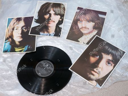 Four giveaway posters included with The Beatles' White Album, showing (from left) John Lennon, George Harrison, Ringo Starr and Paul McCartney.