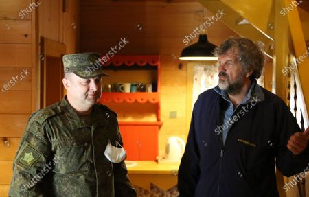 A handout photo made available 30 April 2020 by the press service of the Russian Defense Ministry shows Serbian film director Emir Kusturica (R) and a Russian military specialist inside a house of the wooden ethno village - tourist resort of Drvengrad (also known as Mecavnik) in Mokra Gora, about 240 km southwest of Belgrade, Serbia, 29 April 2020. Serbian film director Emir Kusturica invited Russian military specialists temporarily stationed in the city of Uzice to visit Drvengrad, a wooden village founded and designed by Kusturica. Russia helps Serbia, its longtime West Balkan ally, to combat the spread of the pandemic COVID-19 disease, which is caused by the SARS-CoV-2 coronavirus.
