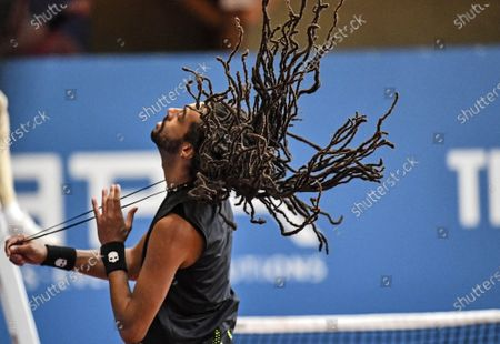 Germany's tennis player Dustin Brown releases his hair during a pro-tennis tournament at a local base tennis academy in Hoehr-Grenzhausen, western Germany, . The professional tennis exhibition in the small village in the Westerwald is a rare exception to the global shutdown of sports during the coronavirus pandemic. Matches are played without line judges and without spectators, and are broadcasted by remote cameras worldwide