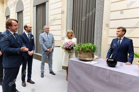 Guests, French Agriculture and Food Minister Didier Guillaume, Brigitte and Emmanuel Macron.