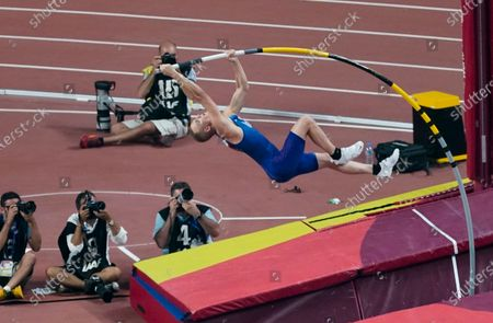 """Sam Kendricks, of the United States, makes an attempt during the men's pole vault at the World Athletics Championships in Doha, Qatar. The three biggest names in men's pole vault will compete against each other from their own backyards, in a rare sporting event during the coronavirus pandemic. Video links will connect world record holder Mondo Duplantis, world champion Sam Kendricks and former Olympic champion Renaud Lavillenie. World Athletics calls it """"The Ultimate Garden Clash"""" and will stream it on social media"""