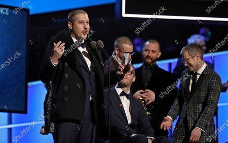 """Stock Picture of Zachary Carothers, left, and fellow members of the band Portugal. The Man accept the award for Best Pop Duo/Group Performance for 'Feel It Still' at the 60th annual Grammy Awards at Madison Square Garden in New York. After the school board at the Matanuska-Susitna Borough School District in Palmer voted 5-2 to remove five classics including F. Scott Fitzgerald's """"The Great Gatsby,"""" """"Joseph Heller's Catch-22"""" and Maya Angelou's """"I Know Why the Caged Bird Sings,"""" the band announced it would buy the books for any student or parent who wanted them"""
