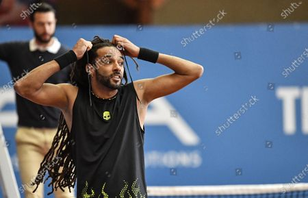 Germany's tennis player Dustin Brown reacts after a match at a pro-tennis tournament at a local base tennis academy in Hoehr-Grenzhausen, western Germany, . The professional tennis exhibition in the small village in the Westerwald is a rare exception to the global shutdown of sports during the coronavirus pandemic. Matches are played without line judges and without spectators, but the matches are broadcasted by remote cameras worldwide