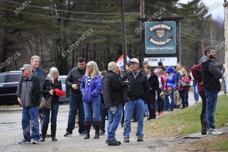 Stock Photo of Crowd waits to get into Sunday River Brewing Company, in Newry, Maine. Rick Savage, owner of the brew pub, defied an executive order that prohibited the gathering of 10 or more people and opened his establishment during the coronavirus pandemic
