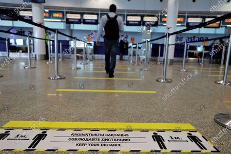 A passenger walks toward a check-in counter at the Nursultan Nazarbayev International Airport in Nur-Sultan, Kazakhstan, on May 1, 2020. Kazakhstan has resumed domestic passenger flights between its capital Nur-Sultan and its largest city Almaty, which were suspended on March 30 due to COVID-19. Kazakhstan has reported 3,550 COVID-19 cases and 25 deaths as of Friday. At the end of April, the Kazakh government eased some COVID-19-related restrictions.