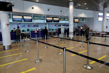 Passengers line up to check in at the Nursultan Nazarbayev International Airport in Nur-Sultan, Kazakhstan, on May 1, 2020. Kazakhstan has resumed domestic passenger flights between its capital Nur-Sultan and its largest city Almaty, which were suspended on March 30 due to COVID-19. Kazakhstan has reported 3,550 COVID-19 cases and 25 deaths as of Friday. At the end of April, the Kazakh government eased some COVID-19-related restrictions.