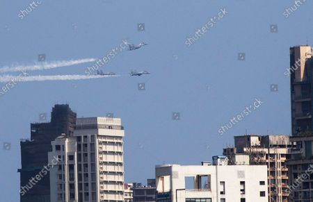 Stock Image of Indian Air Force fighter planes conduct a fly past in Mumbai, India, . The event was part the Armed Forces' efforts to thank the workers, including doctors, nurses and police personnel, who have been at the forefront of the country's battle against the COVID-19 pandemic