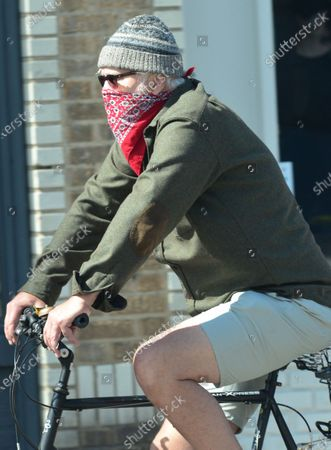 Stock Photo of Exclsuive - Tim Robbins on his bicycle