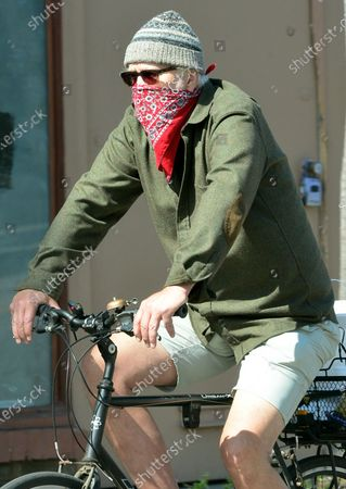 Stock Image of Exclsuive - Tim Robbins on his bicycle