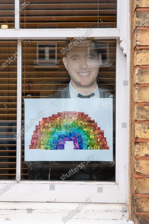 A Michael Buble cut out and rainbow in a house window in Windsor brings a ray of sunshine, hope and positivity during the Coronavirus outbreak