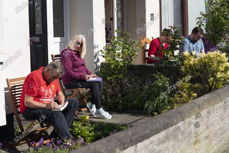 Residents of Dovercliff Road take part in a game of Bingo organised by David Walsh as members of the public find ways to entertain themselves while sticking to government guidelines and observing social distancing in Liverpool, Britain on May 2, 2020.