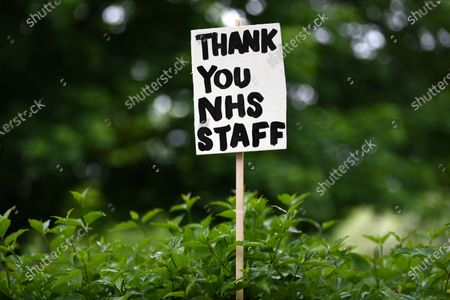 A signs of support for key workers 'Thank You NHS Staff' during the Covid-19 pandemic which are part of an artwork by Peter Liversidge are displayed on a road in east London in Britain, 03 May 2020. Countries around the world are taking increased measures to stem the widespread of the SARS-CoV-2 coronavirus which causes the Covid-19 disease.