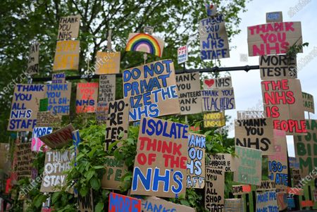 Stock Image of Signs of support for key workers during the Covid-19 pandemic which are part of an artwork by Peter Liversidge are displayed on a road in east London in Britain, 03 May 2020. Countries around the world are taking increased measures to stem the widespread of the SARS-CoV-2 coronavirus which causes the Covid-19 disease.