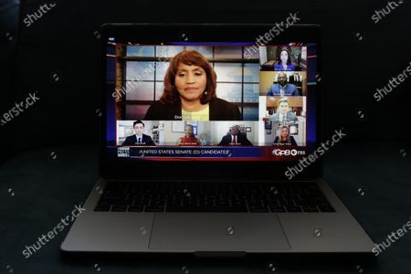 Donna Lowry, center, and Greg Bluestein, right, third from top, host a virtual debate for Georgia's Democratic for Senate candidates, from bottom left, Jon Ossoff, Maya Dillard Smith, James Knox, Marckeith DeJesus, Sarah Riggs Amico Teresa Tomlinson, is seen on a computer screen amid the COVID-19 pandemic, in Atlanta