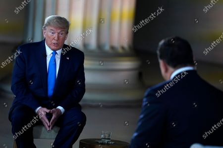 Stock Photo of President Donald Trump speaks during a Fox News virtual town hall from the Lincoln Memorial, in Washington, co-moderated by FOX News anchors Bret Baier and Martha MacCallum