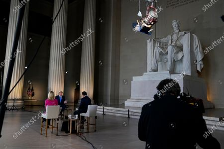 Stock Picture of President Donald Trump speaks during a Fox News virtual town hall from the Lincoln Memorial, in Washington, co-moderated by FOX News anchors Bret Baier and Martha MacCallum